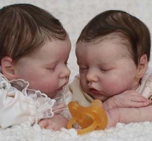 bambole che sembrano bambini veri